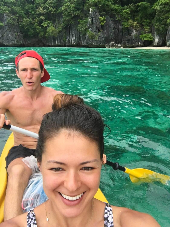 Kim taking a selfie of them paddling a kayak.