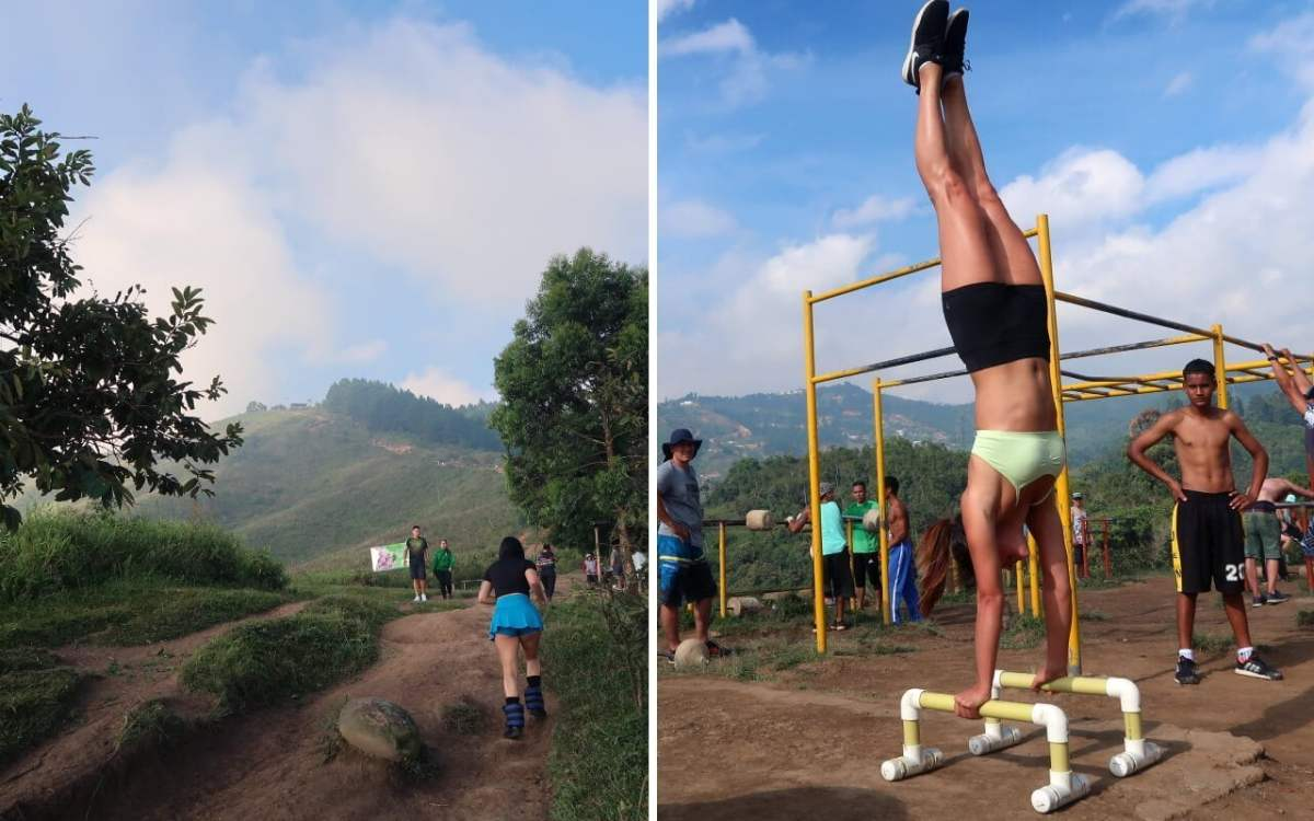ankle weight lady and kim doing a hanstand at the top of cerro las tres cruces medellin