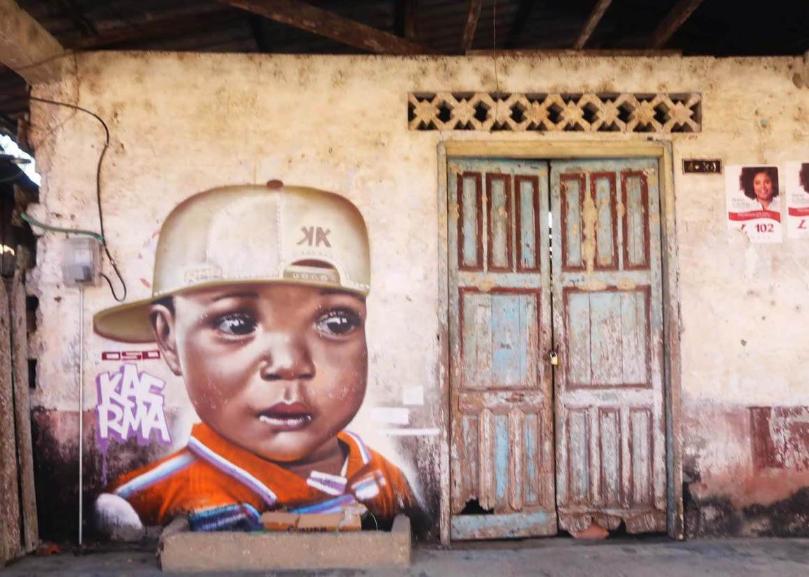 El Valle house with art of child with backwards hat