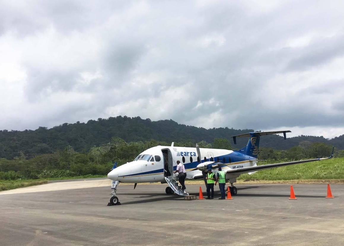 boarding a small plane at Bahia Solano's airport