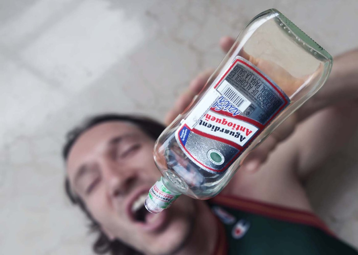 Chugging from a bottle of Colombian aquardiente