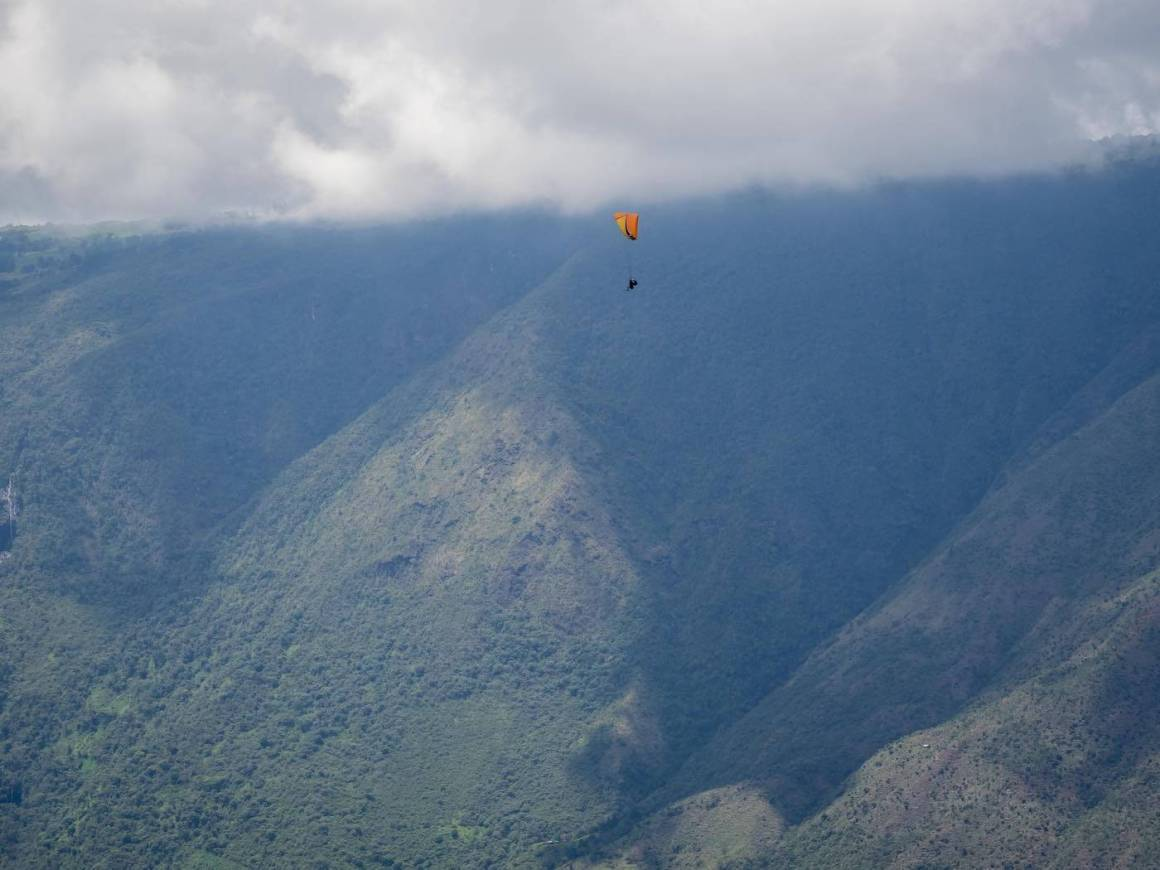 Chris paragliding high in the sky