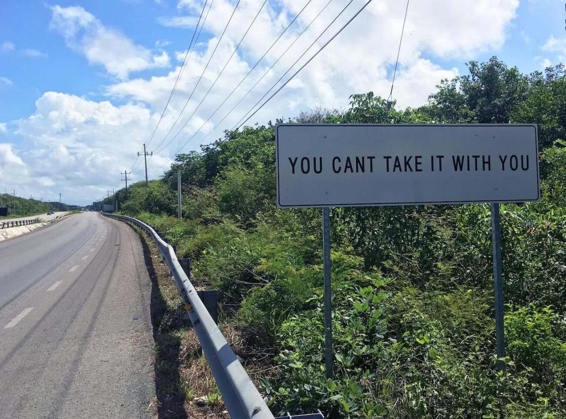 Silly highway sign around Tulum.