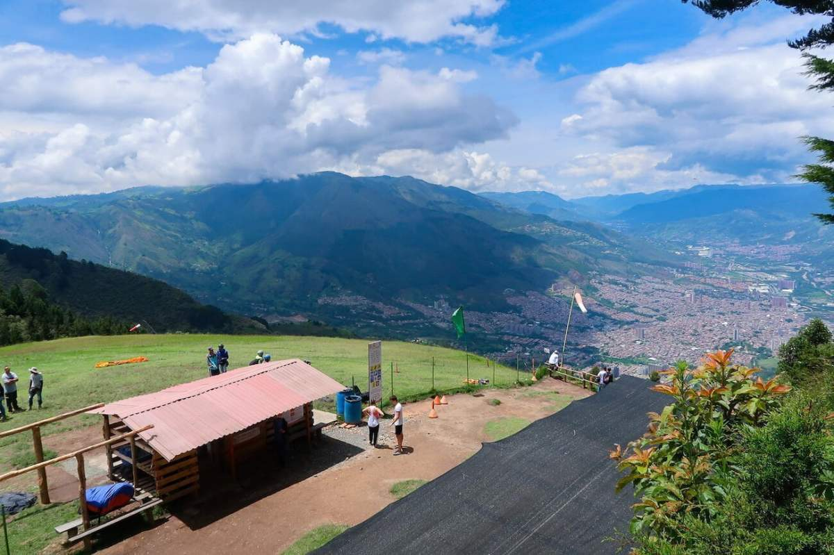 Looking down on the take-off area for Medellin paragliding and the city way below