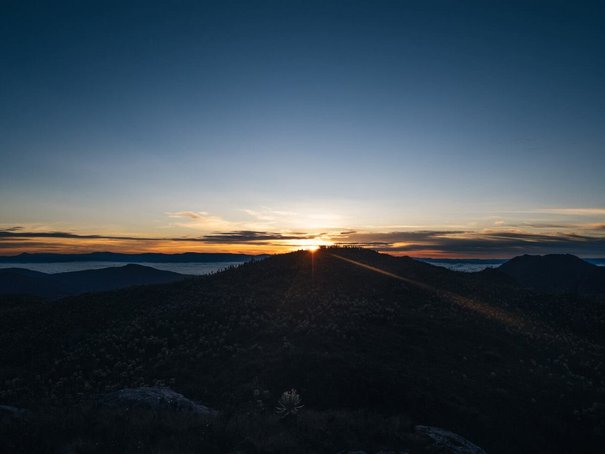 Sun rising over Antioquia viewed from the Paramo del Sol