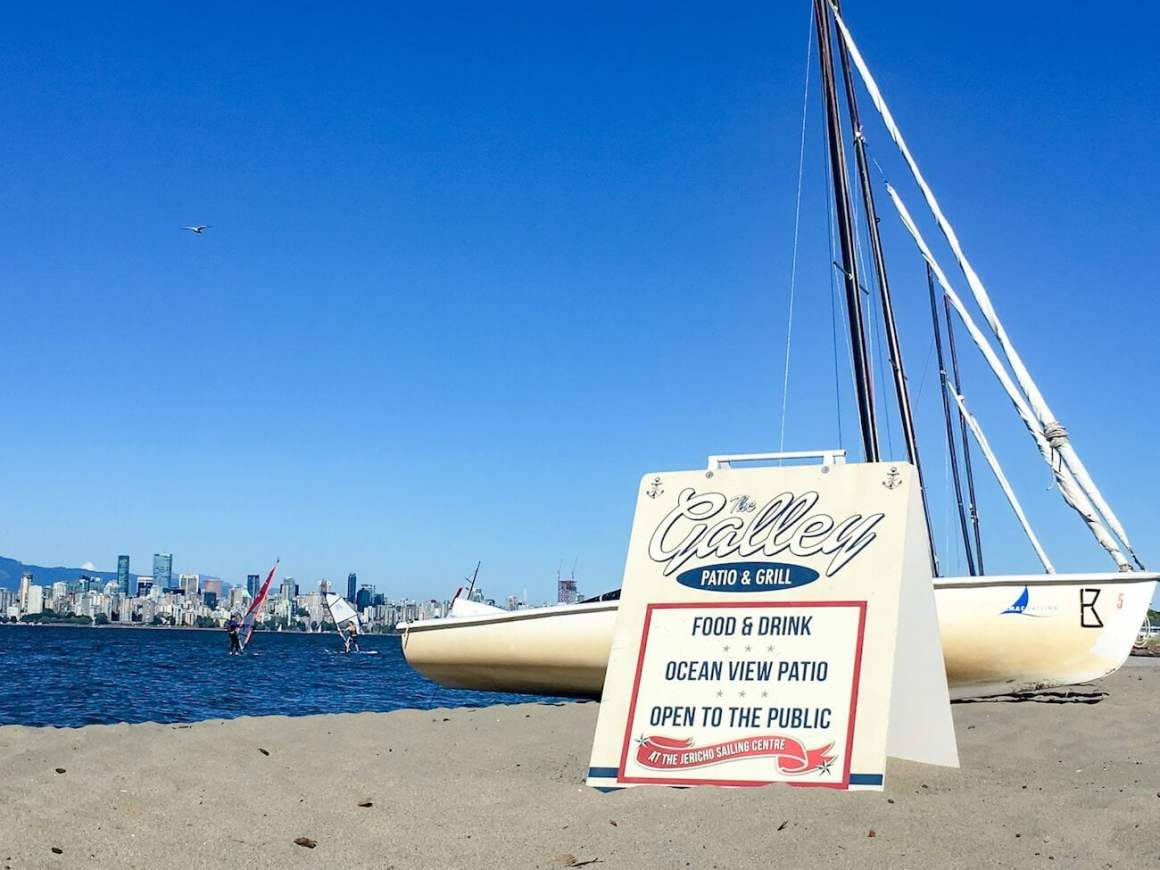 The Galley Grill sign, sailboat, and downtown Vancouver