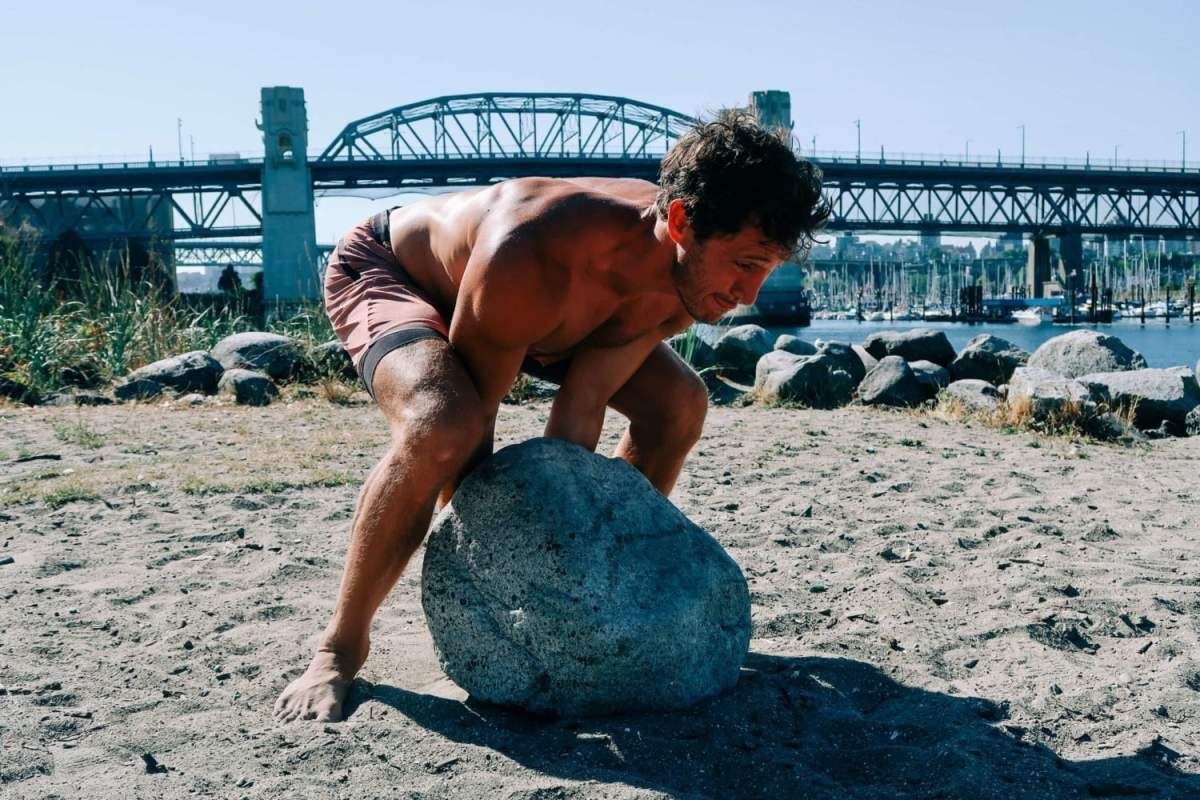 Chris rolling boulder at sunset beach in vancouver