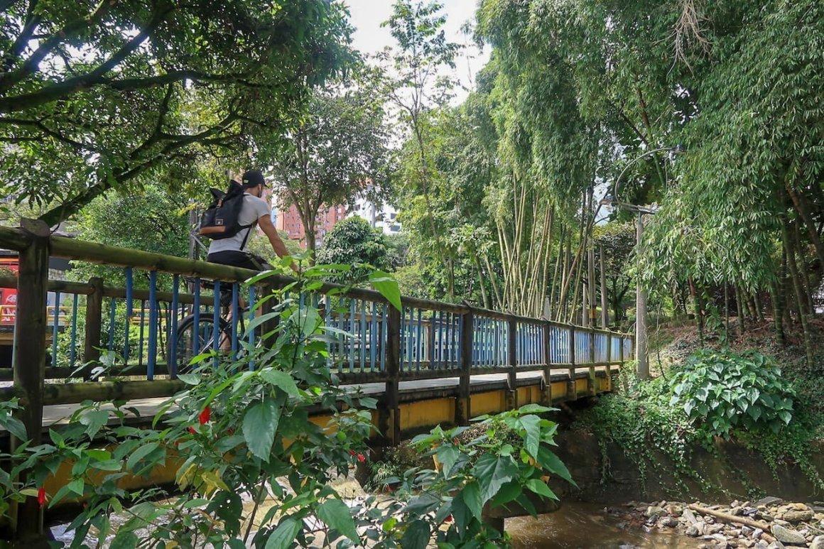 Biker crossing river in El Poblado