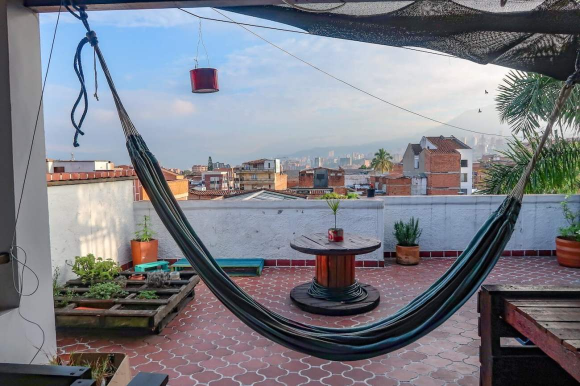 Hammock, patio, and view from our Envigado Airbnb