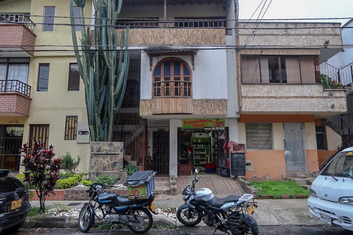 House in El Dorado, Envigado with produce store below.