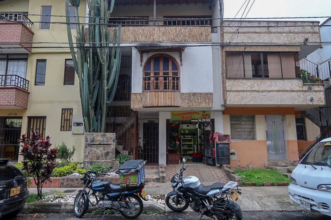 House in El Dorado, Envigado with produce store below.