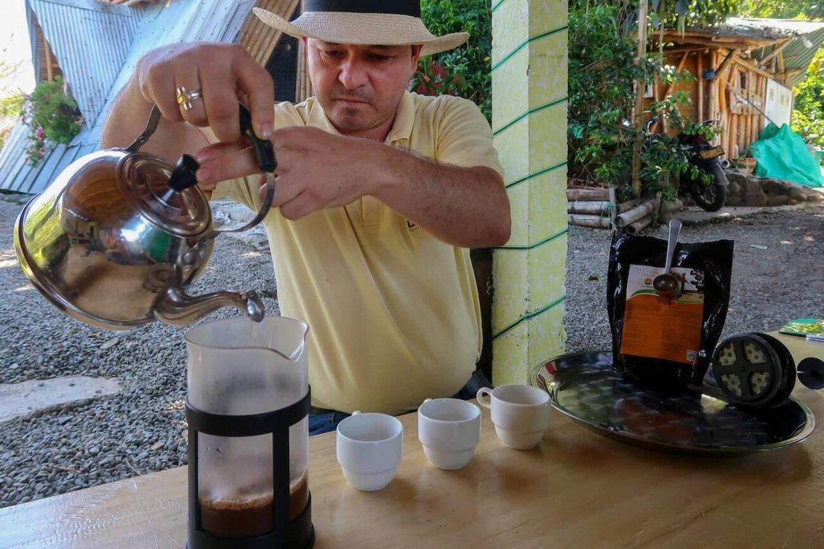 John Wilmar pouring some French press Colombia coffee