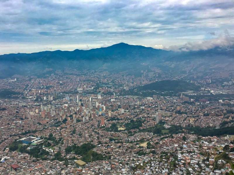Best place to stay in Medellin cover image, an aerial view of Medellin and all its neighborhoods