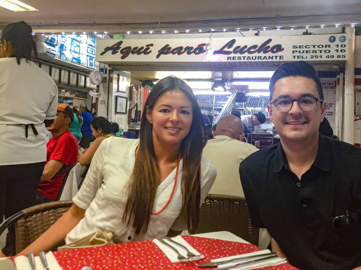 Kim and her brother at table at Aqui Paro Lucho in Medellin