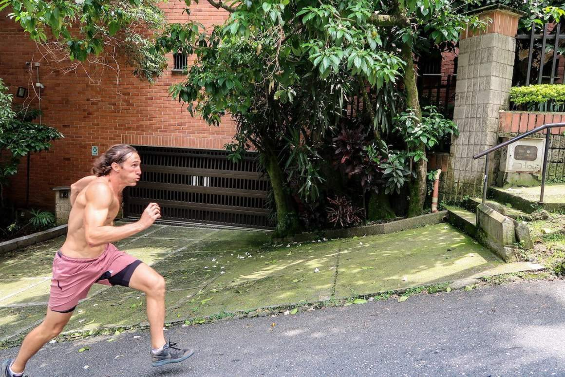 Chris sprinting up a hill in Medellin