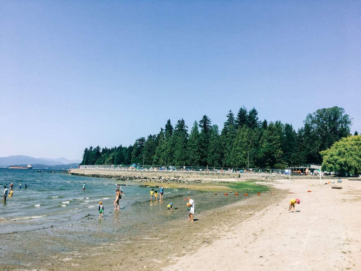 kids playing on the quiet second beach in stanley park in vancouver