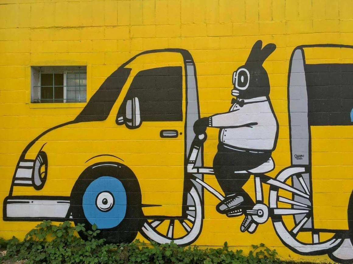 Street art of biker in car