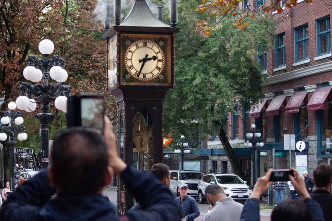 People taking photos of steam clock in Gastown