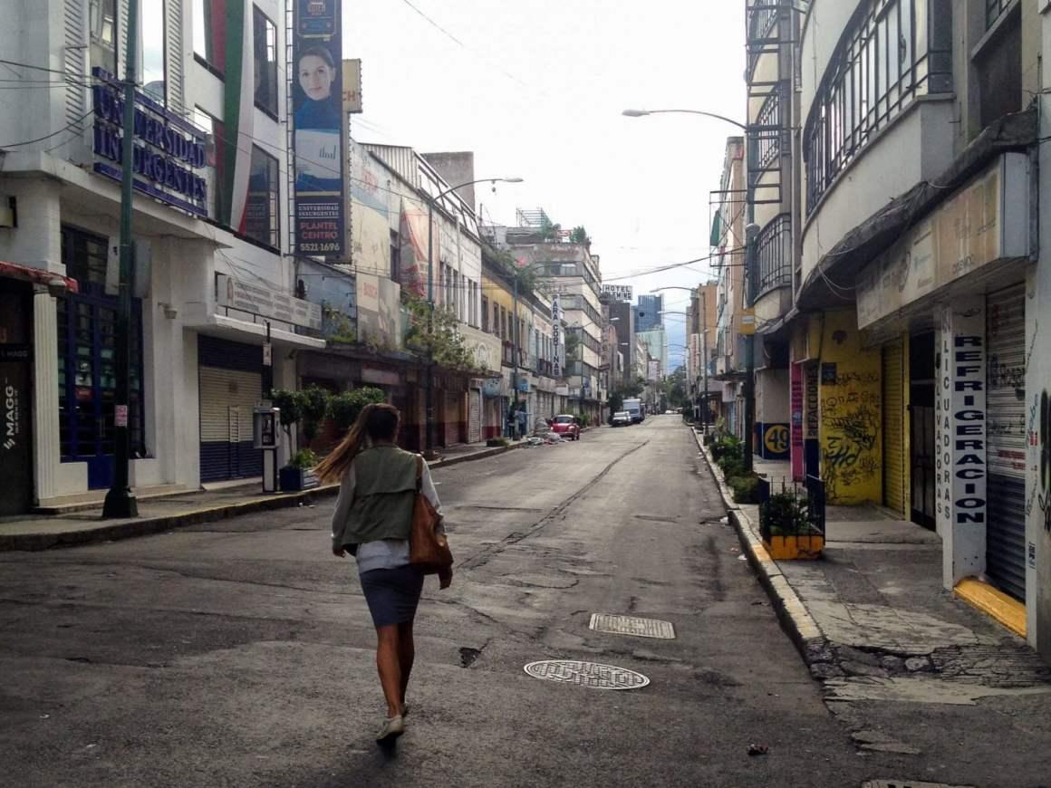 kim walking downtown on empty street mexico city