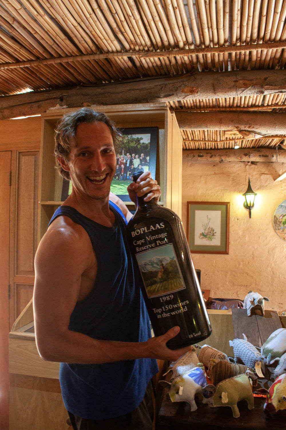Chris holding giant wine bottle at Boplaas
