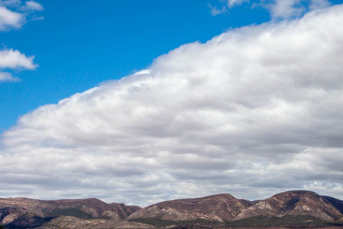 Cloud formation above desert mountains