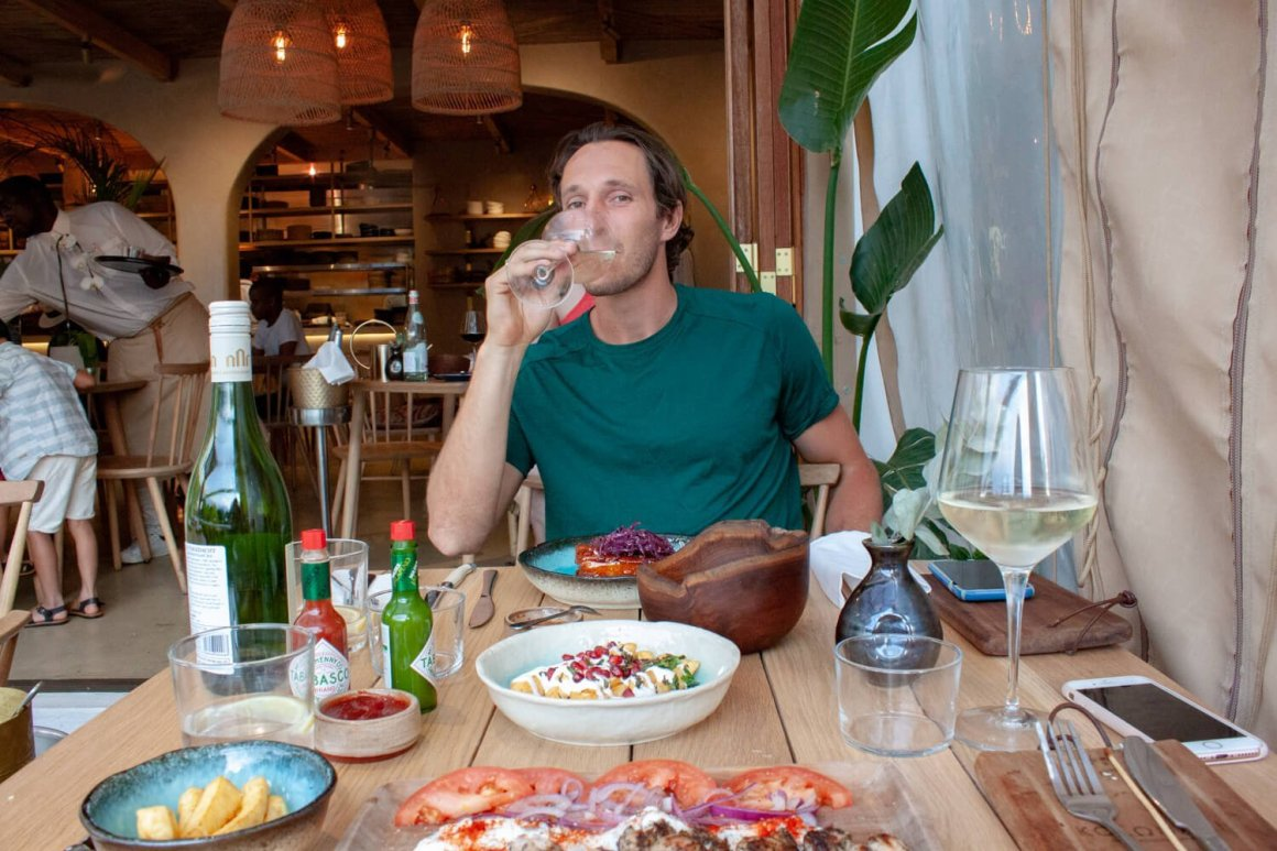 Chris sipping wine during his meal at Kolonaki restaurant