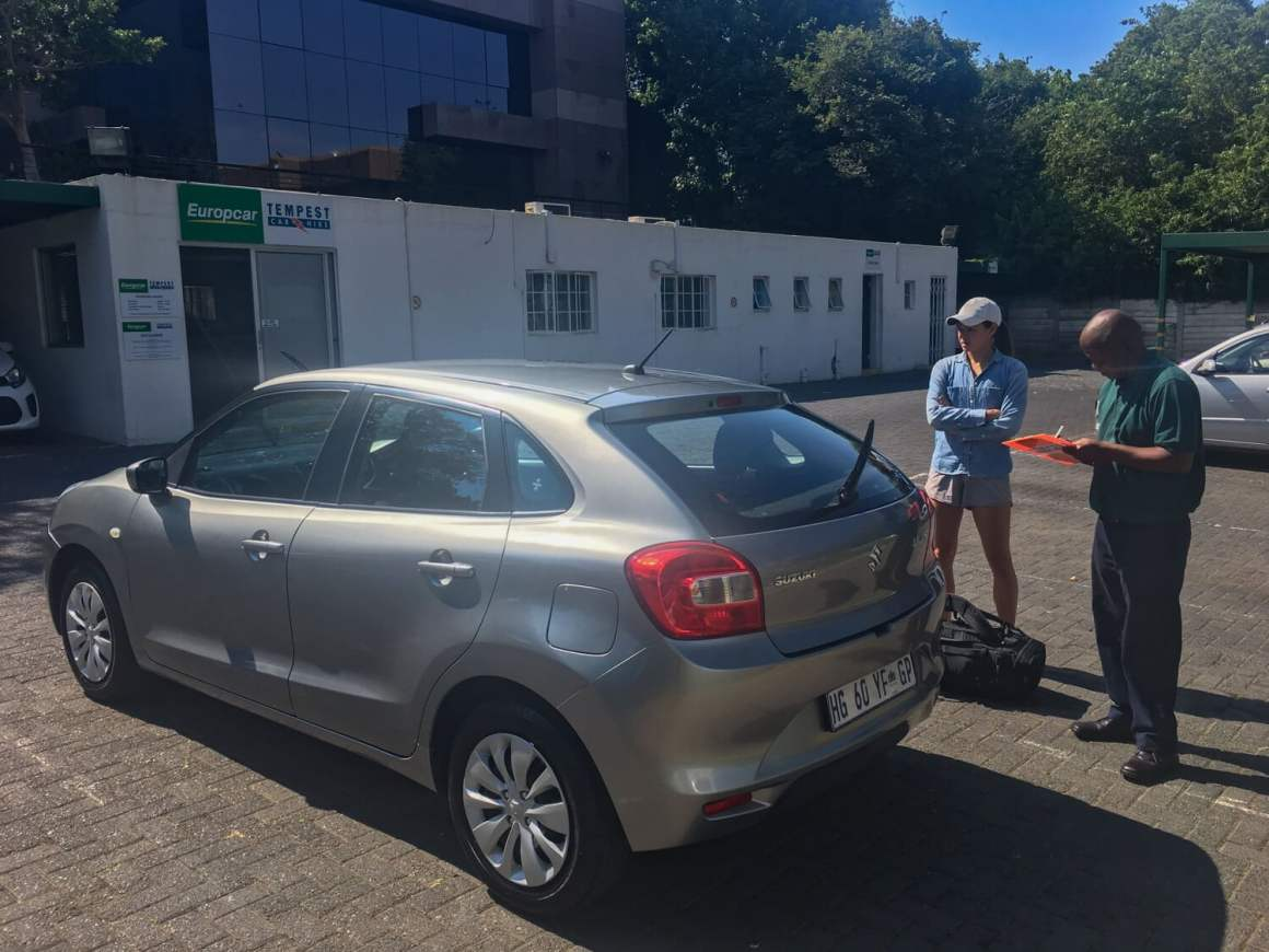 Kim renting our car for our South Africa road trip