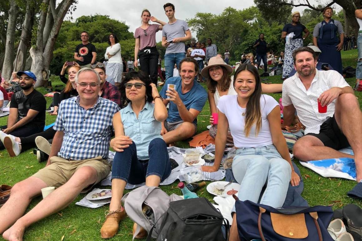 Friends and family enjoying a Kirstenbosch summer concert after a Giovanni's Deli picnic.