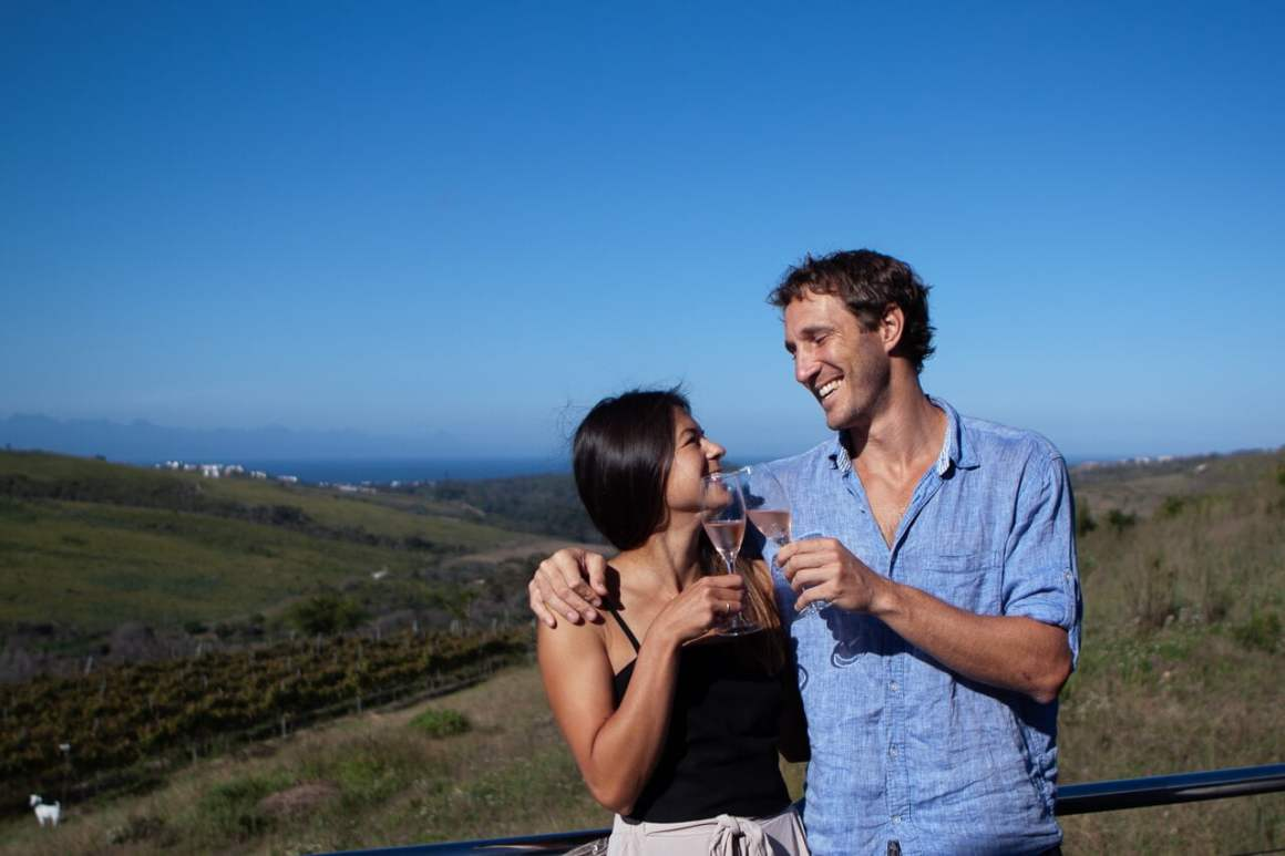 Kim and Chris cheersing at a wine farm outside Plett.