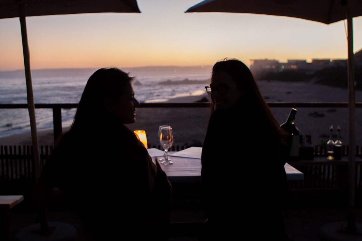 Kim and Rebecca watch the sunset at the famous Enrico's restaurant in Plettenberg Bay.