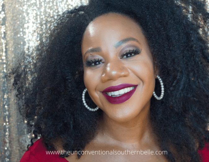 Black woman with big hair and full makeup