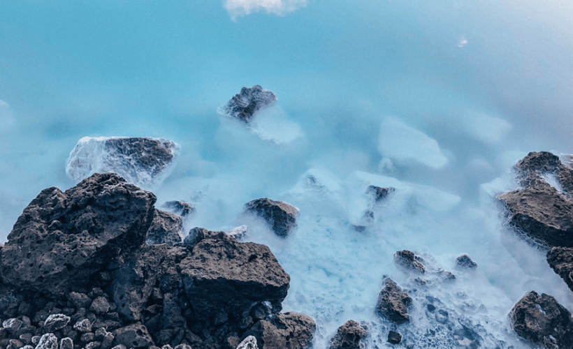 turquoise water with black rocks from The Blue Lagoon Geothermal Spa Iceland