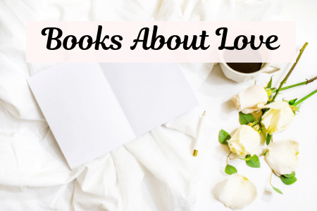 Books About Love with open notebook, white flower, and cup of coffee