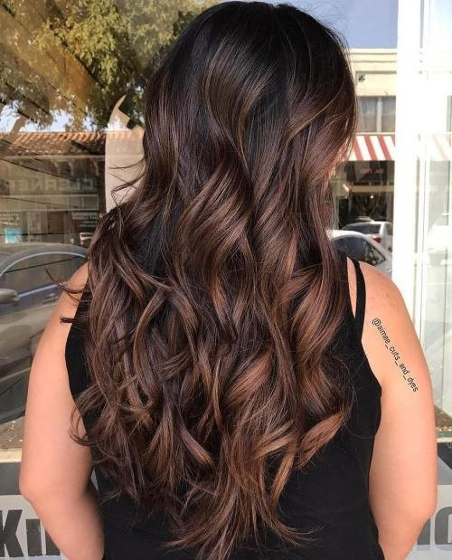 Long-Wavy-Brunette-Hair-with-Soft-Highlights Impressive Haircuts and Hairstyles for Long Dark Brown Hair