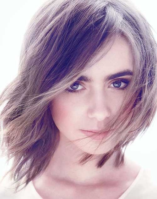 Lily-Collins-Dramatic-Shaggy-Hairstyle Short Shaggy Haircuts
