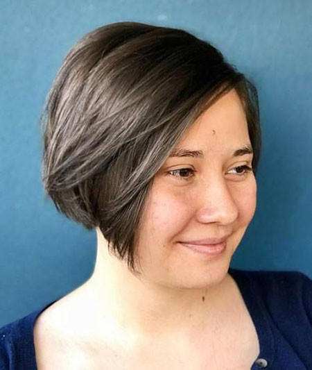 Angled-Parted-Bob-for-Round-Face Short Haircuts for Women with Round Faces