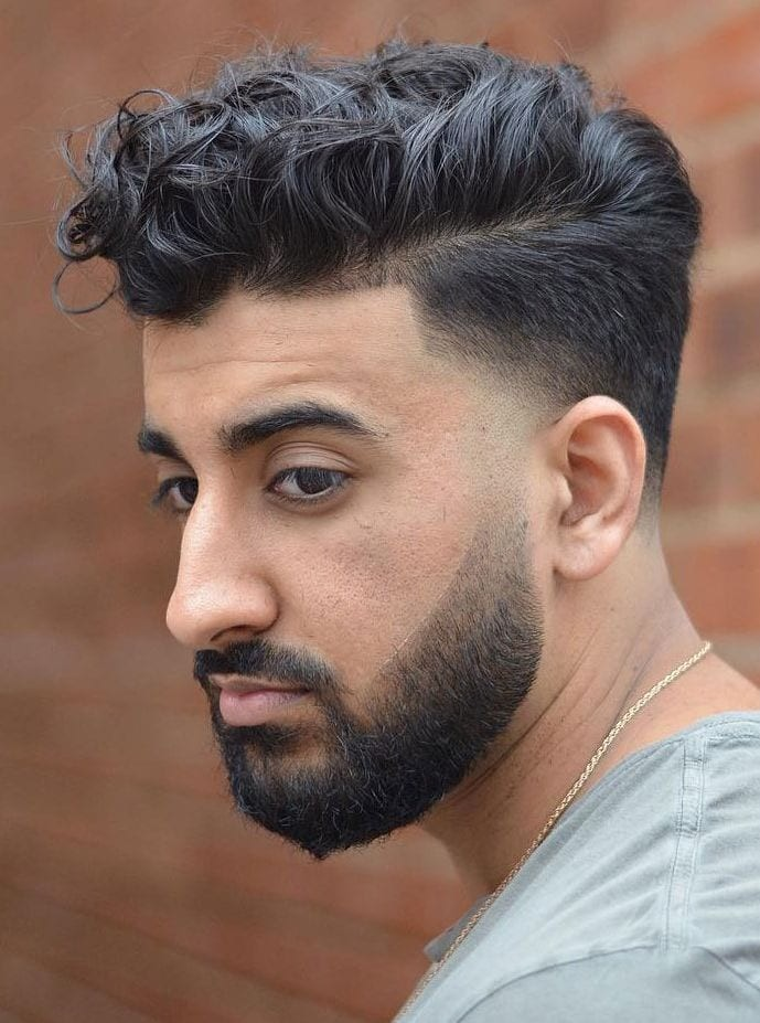 Loose-Curly-Hair-Undercut-Fade Stylish Undercut Hairstyle Variations in 2019: A Complete Guide