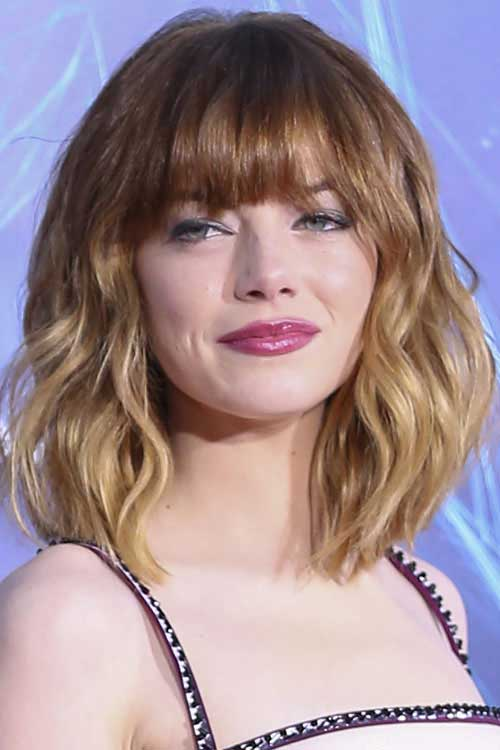 Emma-Stone's-Wavy-Hair-with-Bangs Short Wavy Hairstyles With Bangs