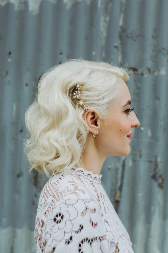 Curly-Bob-with-Hair-Clip Wedding Hair Ideas for Spring