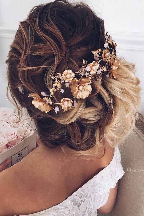 Low-Bun-for-Curly-Hair Wedding Hair Ideas for Spring