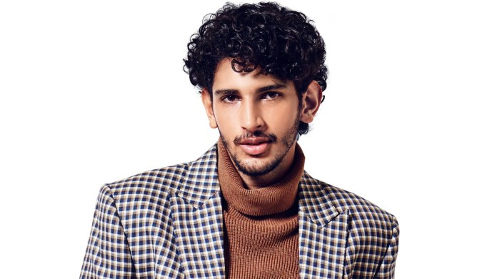 Medium-Curls-and-a-Beard Insanely Cool Hairstyles for Indian Men