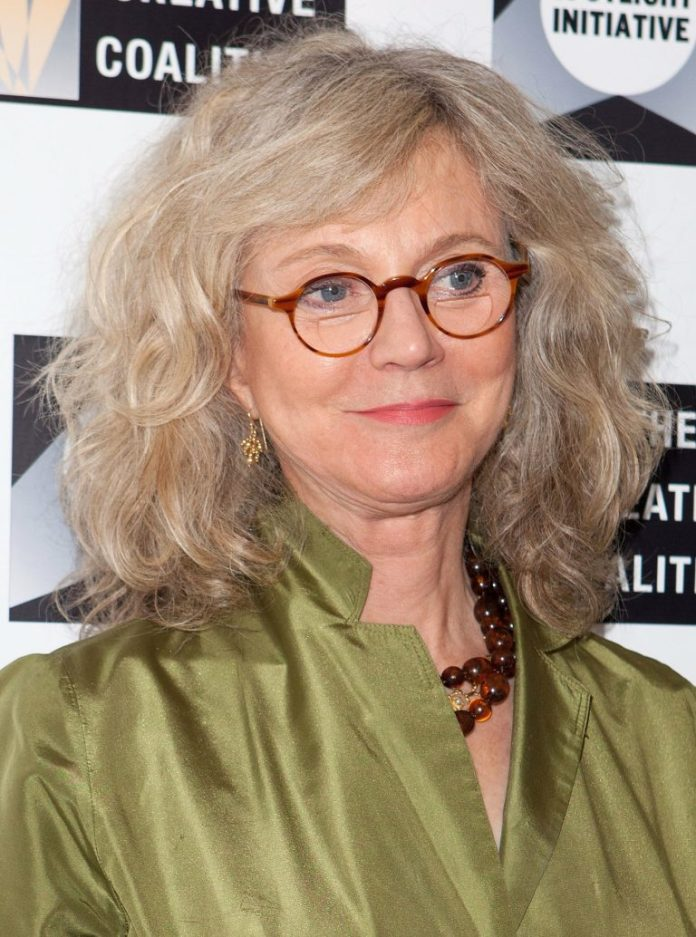 Medium-Long-Hair-with-Curls Hairstyles for Women Over 50 With Glasses