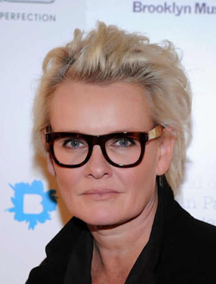 Pixie-Haircut-With-The-Sides-Styled-Toward-The-Back Hairstyles for Women Over 50 With Glasses