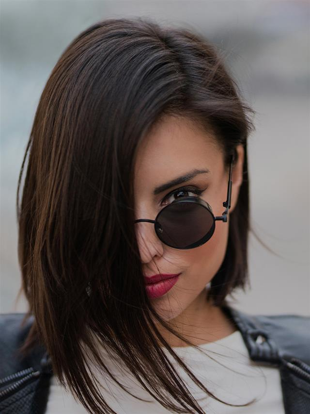 Side-Parted-Asymmetric-Bang-Bob Top Trending Medium Hairstyles for Girls