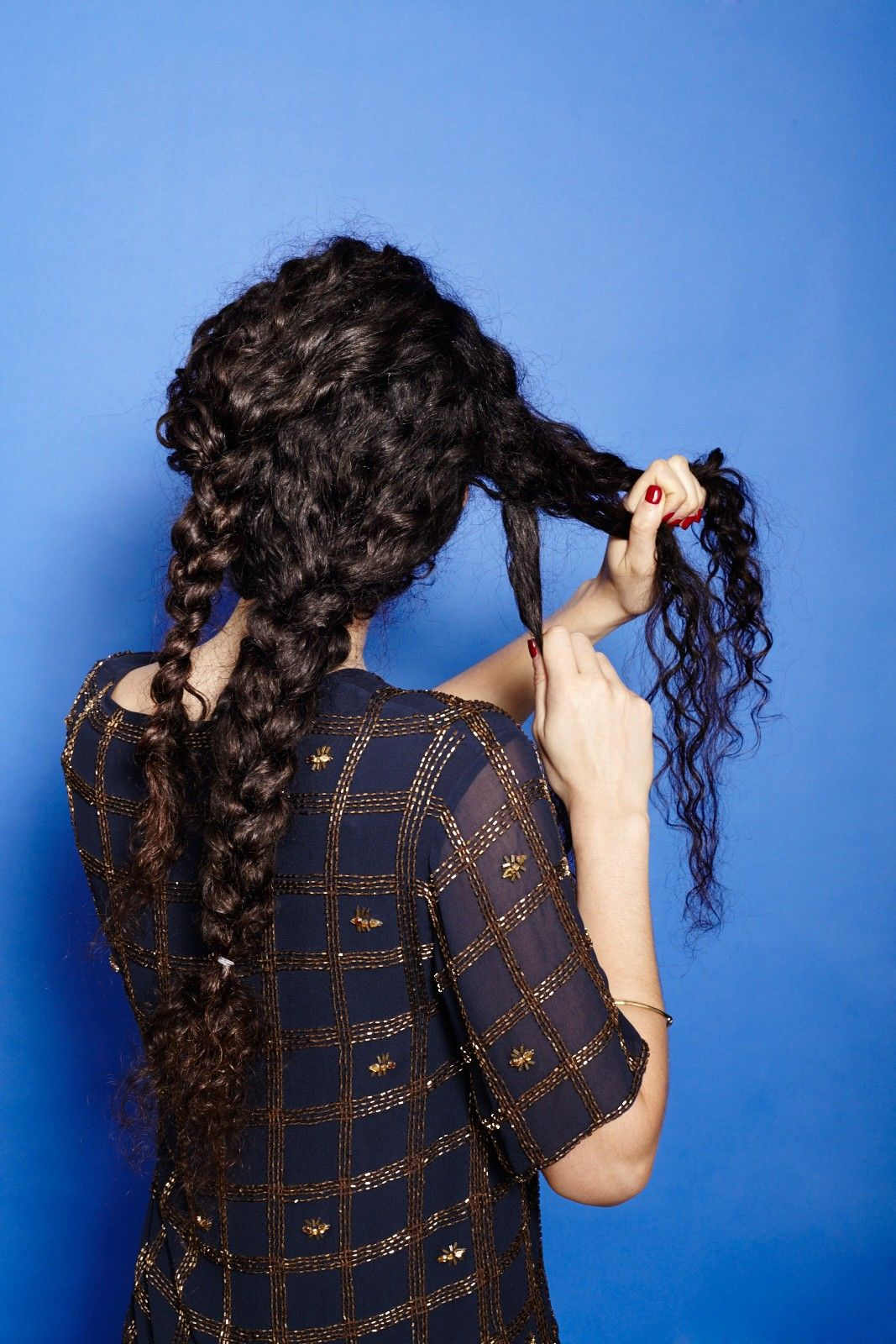 Unruly-Braid-in-Narrow-Curly-Hair Worth Trying Curly Hairstyles with Braids