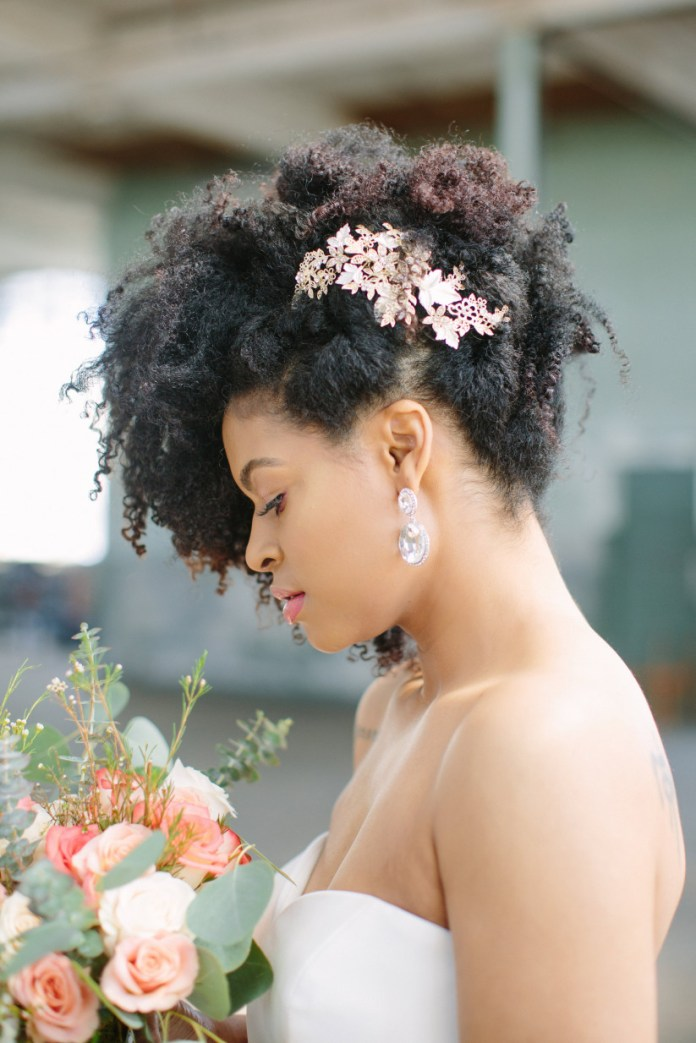 Chunky-Short-Wavy-Curls-Adorned-with-a-Side-Tiara Most Stylish Afro Hairstyles for Women to Look Stunning
