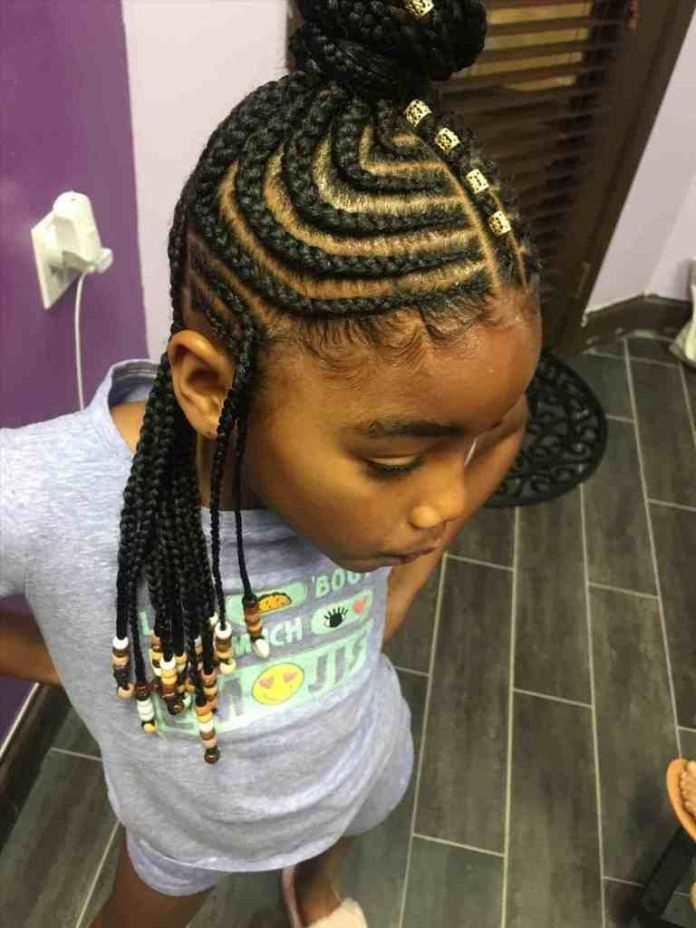 Circular-Cornrows-with-a-High-Bun-and-Flowing-Braids Cutest African American Kids Hairstyles