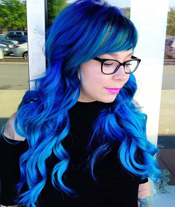 Electric-Blue-Curls-And-Side-Swept-Fringe Layered Hairstyles With Bangs