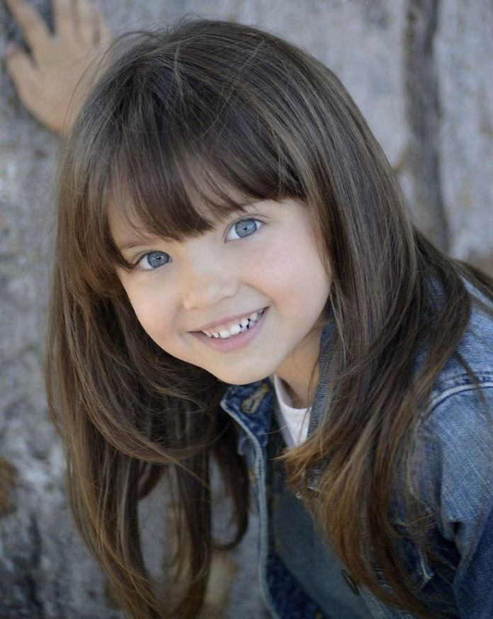 Funky-Sleek-Hairstyle-with-Bangs Cute and Adorable Little Girl Haircuts