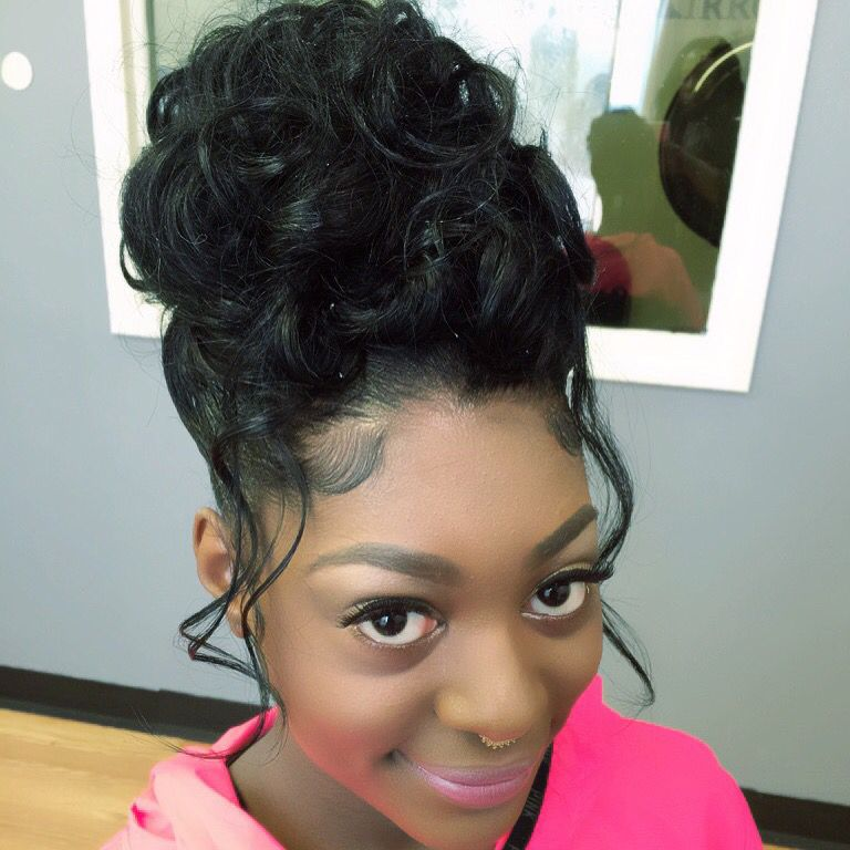 High-Bun-Prom-Hairstyle-with-Scattered-Curly-Strands-All-Over Most Stylish Prom Hairstyles for Black Girls